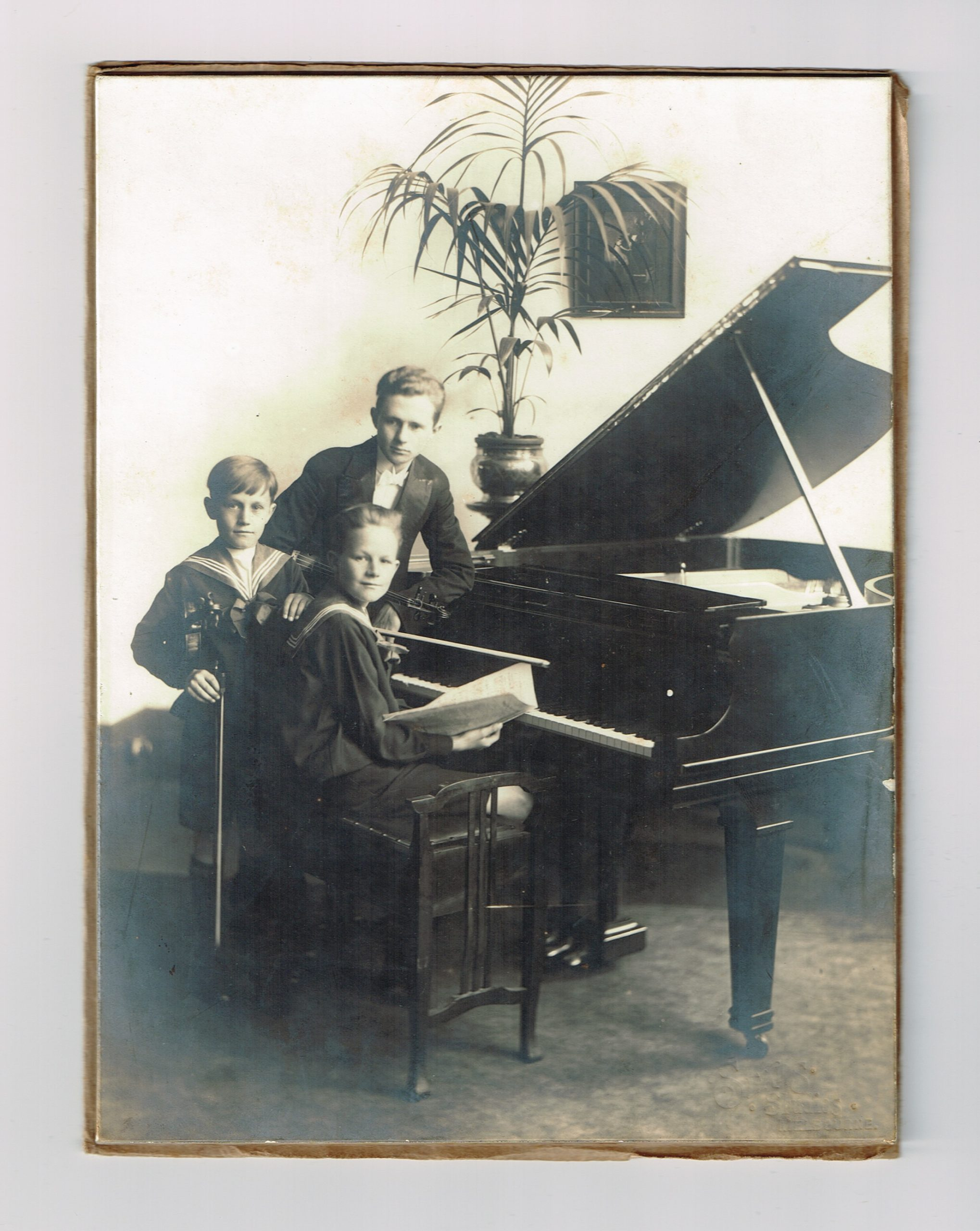 Milton at Piano with Brothers